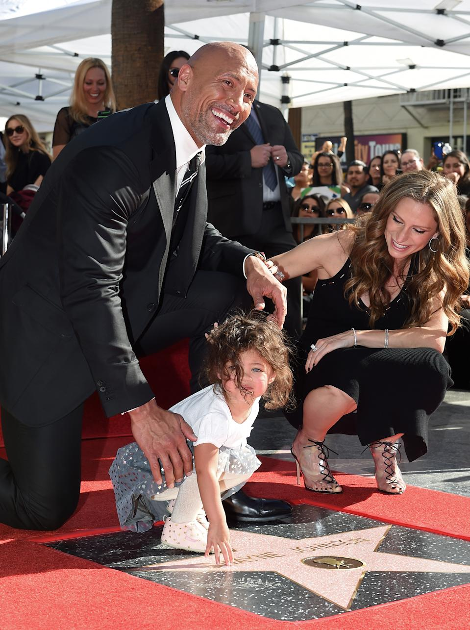 HOLLYWOOD, CA - DECEMBER 13:  Actor Dwayne Johnson, wife Lauren Hashian and daughter Jasmine Johnson attend the ceremony honoring Dwayne Johnson with star on the Hollywood Walk of Fame on December 13, 2017 in Hollywood, California.  (Photo by Axelle/Bauer-Griffin/FilmMagic)