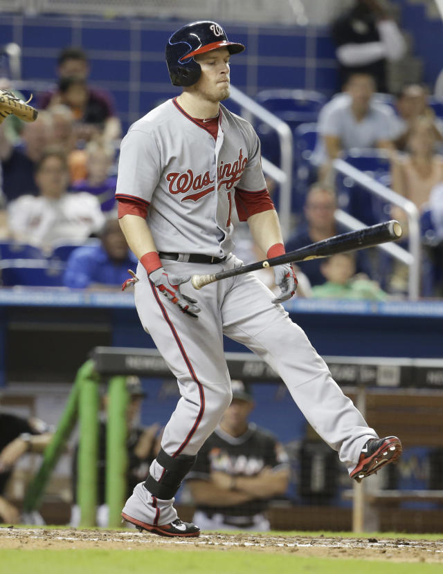 Washington Nationals' Nate McLouth reacts after he struck out swinging in the eighth inning during a baseball game against the Miami Marlins, Tuesday, July 29, 2014, in Miami. The Marlins defeated the Nationals 3-0. (AP Photo/Lynne Sladky)