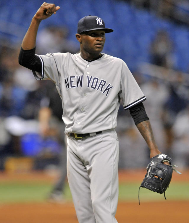 New York Yankees reliever German Domingo pumps his fist after the final out of the team's 9-2 win over the Tampa Bay Rays during a baseball game Tuesday, Sept. 25, 2018, in St. Petersburg, Fla. (AP Photo/Steve Nesius)