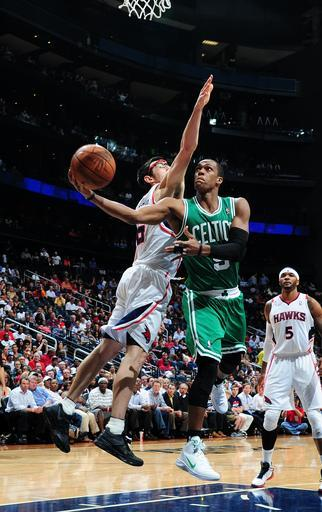 ATLANTA, GA - MARCH 19: Rajon Rondo #9 of the Boston Celtics goes to the basket against Kirk Hinrich #6 of the Atlanta Hawks on March 19, 2012 at Philips Arena in Atlanta, Georgia. (Photo by Scott Cunningham/NBAE via Getty Images)
