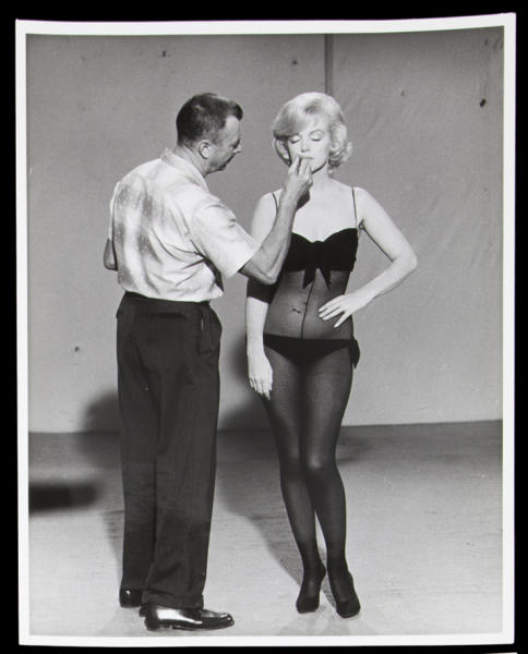 """This image, taken in 1960, released by Julien's Auctions, shows a black and white photograph of Allan """"Whitey"""" Snyder applying Marilyn Monroe's makeup on the set of """"Lets Make Love.""""  This item is part of Julien's Auctions Hollywood Legends being held on Saturday, March 31, 2012 and Sunday April 1 in Beverly Hills, Calif. (AP Photo/Julien's Auctions)"""