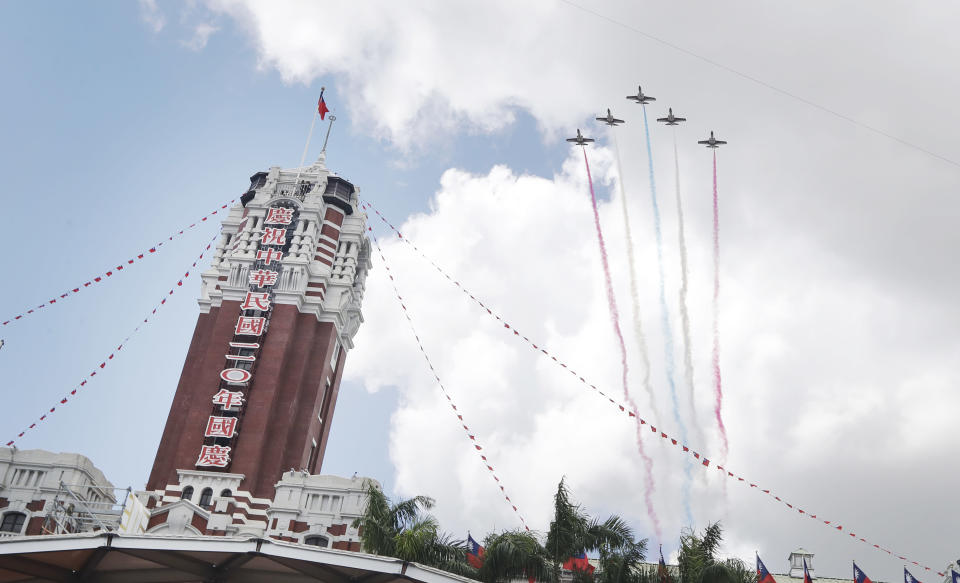 Thunder Tiger Aerobatics Team fly over President Office during National Day celebrations in Taipei, Taiwan, Sunday, Oct. 10, 2021. (AP Photo/Chiang Ying-ying)