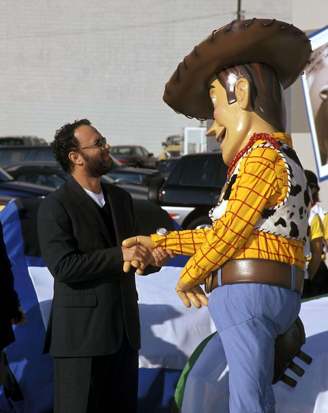 """HOLLYWOOD - OCTOBER 23: Actor Tom Hanks and Woody attend the """"Toy Story 2"""" Themed NASCAR Racing Cars Unveiling on October 23, 1999 at the El Capitan Theatre in Hollywood, California. (Photo by Ron Galella, Ltd./WireImage)"""