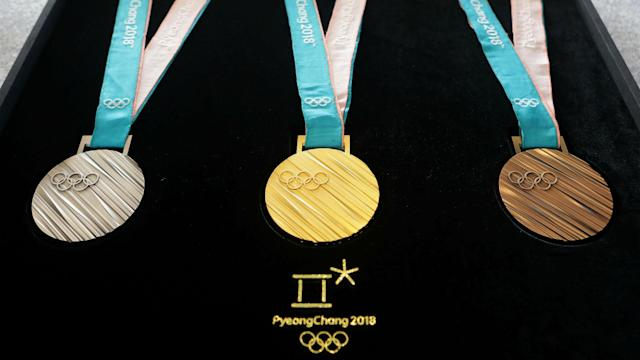 Which countries are leading the way in visits to the podium in Pyeongchang?