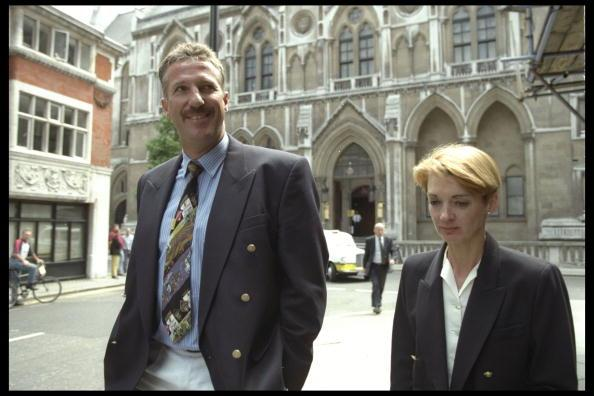 16 Jul 1996:  Ian Botham and wife Kathy leave court during the libel case in the high court between Ian Botham and Imran Khan. Mandatory Credit: John Parkin/Allsport UK