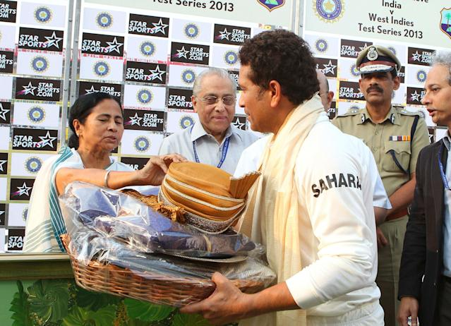 Mamata Banerjee (Chief Minister of West Bengal) presents Sachin Tendulkar with a memento during day three of the first Star Sports test match between India and The West Indies held at The Eden Gardens Stadium in Kolkata, India on the 8th November 2013 Photo by: Ron Gaunt - BCCI - SPORTZPICS