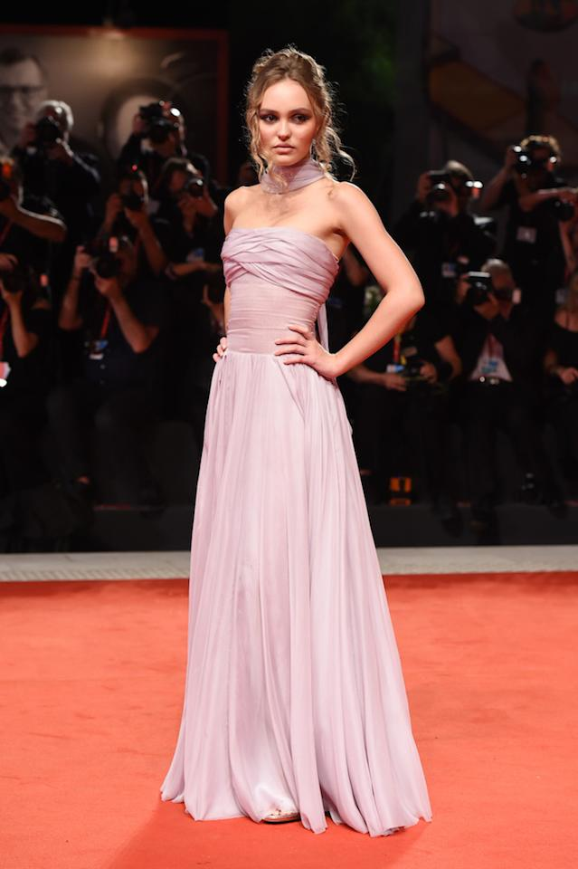The actress attended the 'The King' premiere to support of boyfriend Timothée Chalamet in a lilac grecian gown (complete with a chic neck-tie) by go-to brand, Chanel. <em>[Photo: Getty]</em>