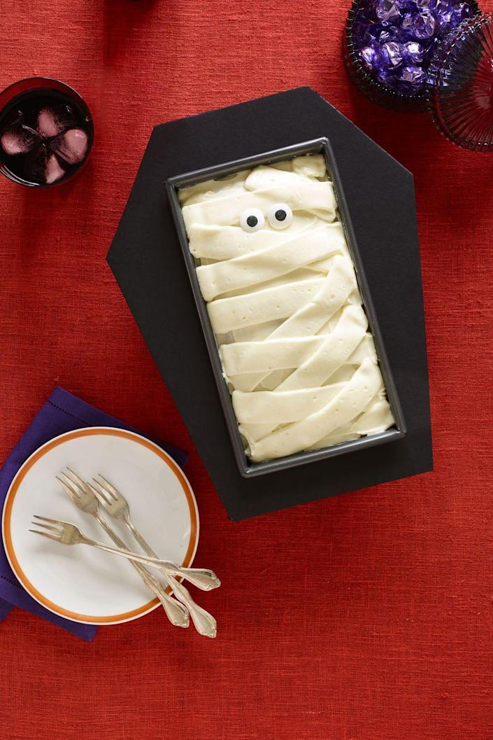 """<p>This festive cake is <em>almost</em> too cute to eat! And you can wrap up the decadent red velvet cake in a foamboard coffin using <a href=""""https://www.womansday.com/home/crafts-projects/g3200/halloween-2017-templates/"""" rel=""""nofollow noopener"""" target=""""_blank"""" data-ylk=""""slk:this free template"""" class=""""link rapid-noclick-resp"""">this free template</a>.</p><p><em><strong><a href=""""https://www.womansday.com/food-recipes/food-drinks/recipes/a60153/coffin-cake-recipe/"""" rel=""""nofollow noopener"""" target=""""_blank"""" data-ylk=""""slk:Get the Coffin Cake recipe."""" class=""""link rapid-noclick-resp"""">Get the Coffin Cake recipe.</a></strong></em></p>"""