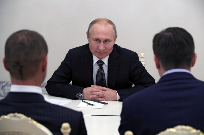 Putin attends a meeting with UEFA President Ceferin in Saint Petersburg