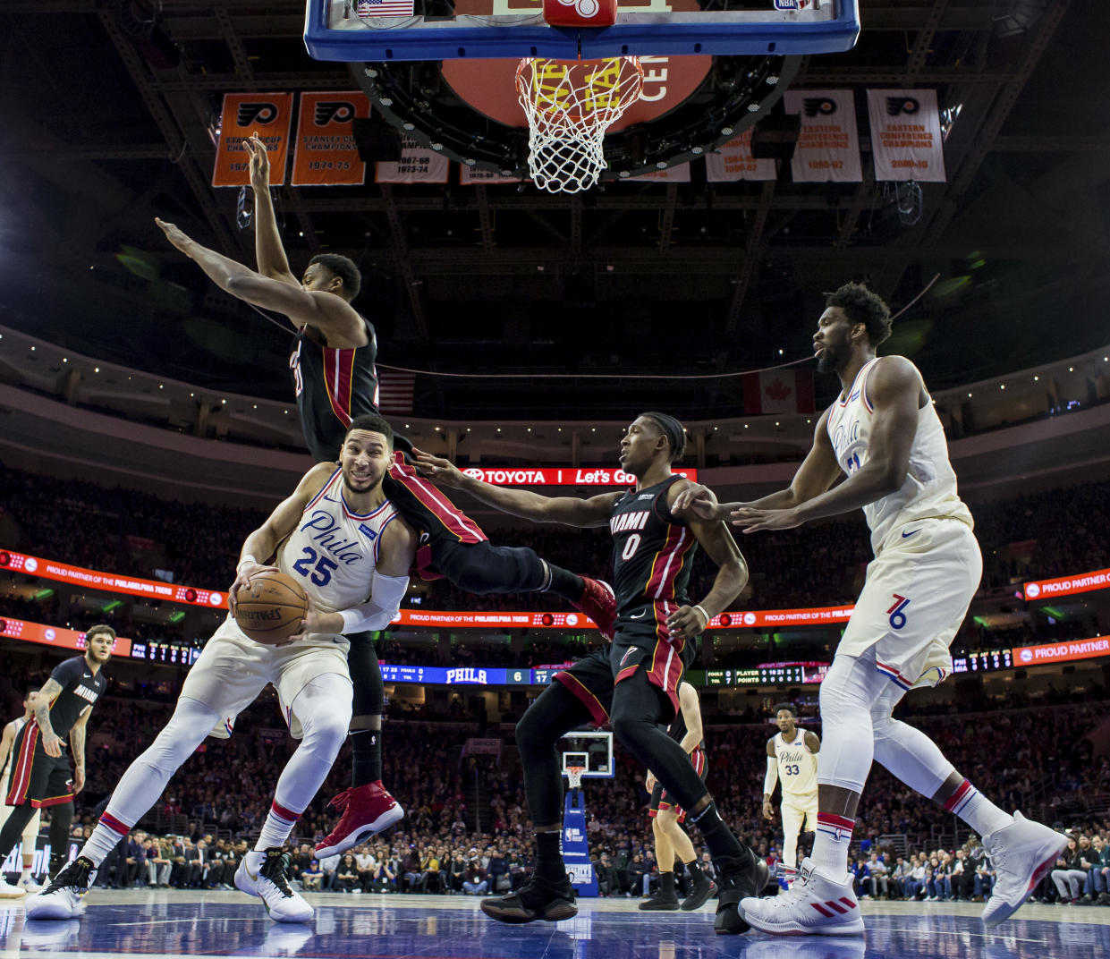 "Ben Simmons, Joel Embiid and Co. punctuated the arrival of ""The Process"" ahead of schedule Tuesday, completing a dominant series win over the Heat. (AP)"