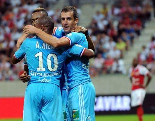 Marseille's French midfielder Benoit Cheyrou (R) celebrates with teammates after scoring