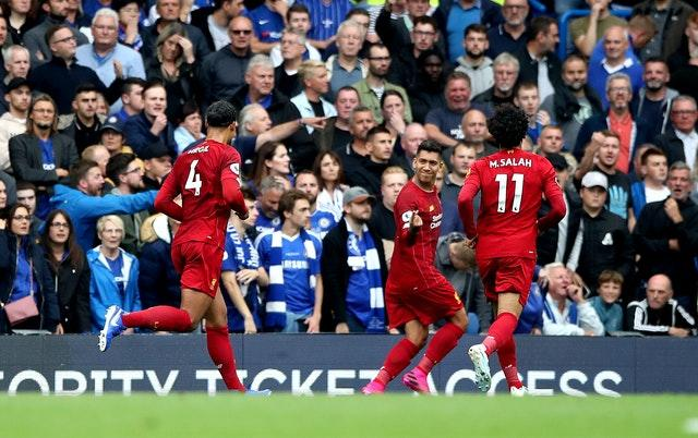Roberto Firmino, second right, celebrates scoring Liverpool's second goal during the 2-1 win over Chelsea in September. Victory at Stamford Bridge extended the Reds' unbeaten start to six top-flight games while inflicting a first Premier League loss on Blues boss Frank Lampard