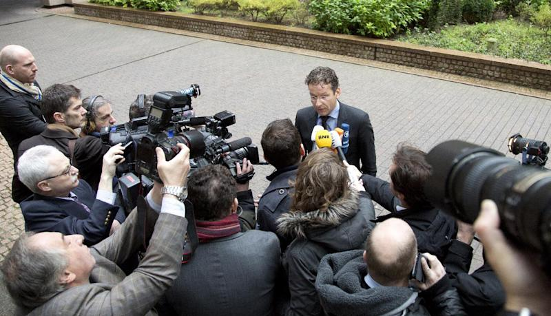 Dutch Finance Minister Jeroen Dijsselbloem speaks with the media as he arrives for a meeting of the eurogroup at the EU Council building in Brussels on Thursday, Nov. 14, 2013, as finance ministers from the 17-country eurozone try to make progress on creating a banking union. The ministers need to agree before the end of the year on how to set up a fund to rescue banks. (AP Photo/Virginia Mayo)