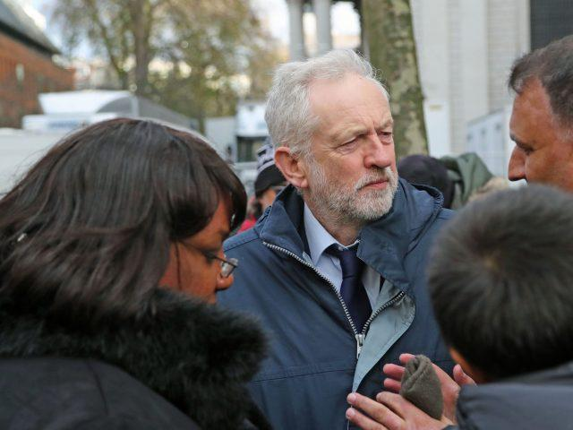 Labour leader Jeremy Corbyn and Diane Abbott speak with people after the service (Gareth Fuller/PA)