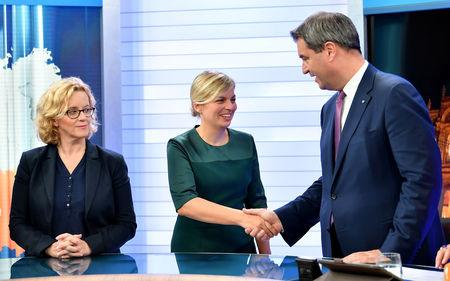 Social Democratic Party (SPD) top candidate Natascha Kohnen, the Greens party top candidate Katharina Schulze and Bavarian Prime Minister Markus Soeder take part in an interview at a TV studio following the Bavarian state election in Munich, Germany, October 14, 2018.    Lukas Barth-Tuttas/Pool via Reuters