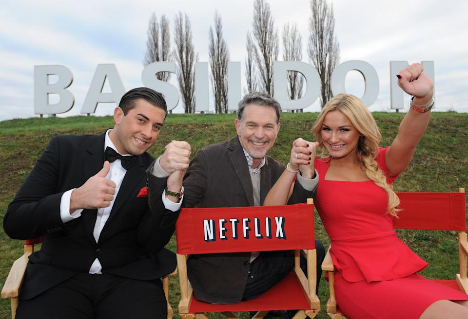 "James ""Arg"" Argent (left) and Sam Faiers (right) from The Only Way Is Essex join Netflix CEO Reed Hastings (centre) to bring a bit of Hollywood glamour to Basildon at the launch of Netflix, the Worlds leading Film and Television streaming service, in the UK. (Photo by PA Images via Getty Images)"