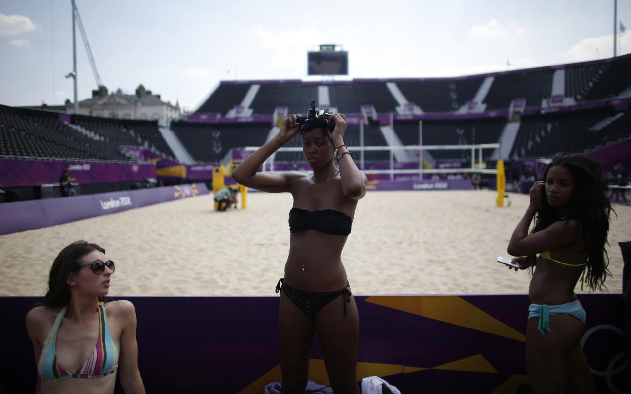 Dancers prepare to rehearse their performance for the London 2012 Olympic beach volleyball matches at the main court at the Horse Guards Parade in London July 25, 2012. REUTERS/Marcelo del Pozo (BRITAIN - Tags: SPORT OLYMPICS VOLLEYBALL)