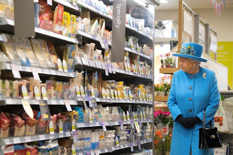 Queen Elizabeth II looking at the specialty products section of a Waitrose supermarket during a visit to the town of Poundbury, England, October 2016.