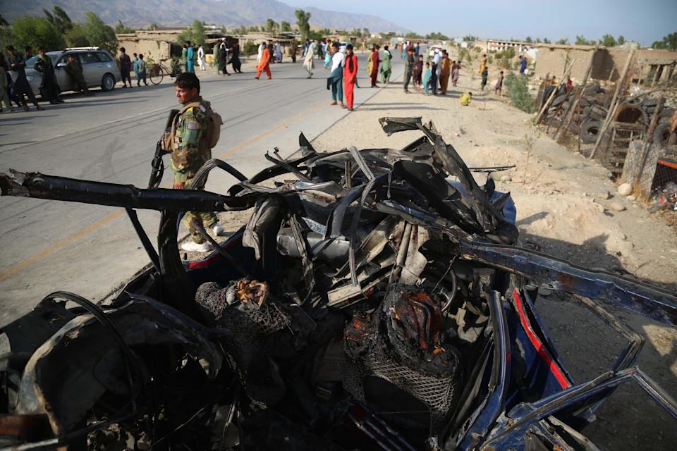 Afghan security officials inspect the scene of a roadside bomb blast that killed six civilians on the outskirts of Jalalabad, Afghanistan (EPA)