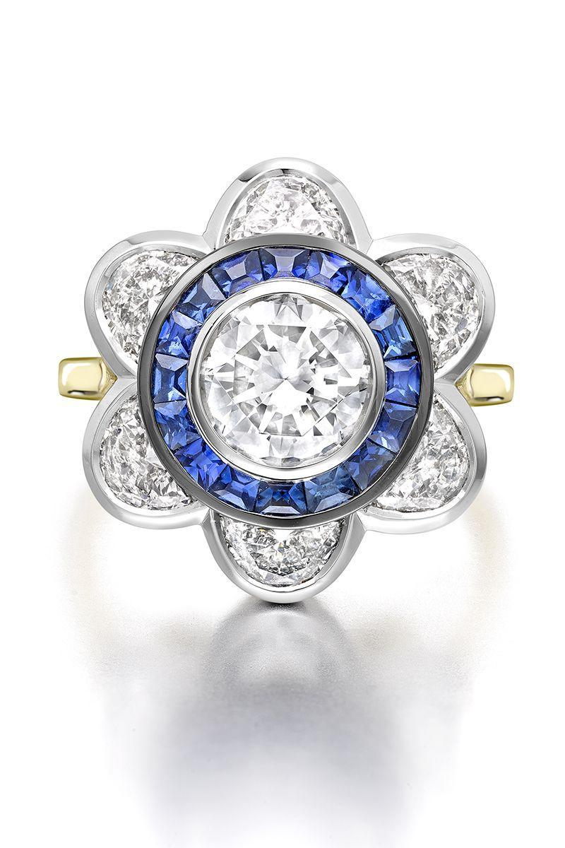 "<p><em><strong><strong>Jessica McCormack</strong> </strong>""Moonshine Diamond & Sapphire Daisy Ring"" with grey diamond, a halo of carré cut blue sapphires and half-moon shaped diamonds in 18k white and yellow gold, price upon request, <a href=""http://www.jessicamccormack.com/"" rel=""nofollow noopener"" target=""_blank"" data-ylk=""slk:jessicamccormack.com"" class=""link rapid-noclick-resp"">jessicamccormack.com</a>.</em></p><p><a class=""link rapid-noclick-resp"" href=""http://www.jessicamccormack.com/"" rel=""nofollow noopener"" target=""_blank"" data-ylk=""slk:SHOP"">SHOP</a></p>"