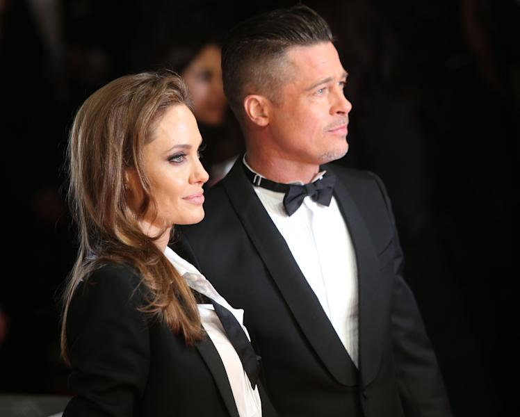 Actors Angelina Jolie and Brad Pitt pose for photographers on the red carpet at the EE British Academy Film Awards held at the Royal Opera House on Sunday Feb. 16, 2014, in London. (Photo by Joel Ryan/Invision/AP)
