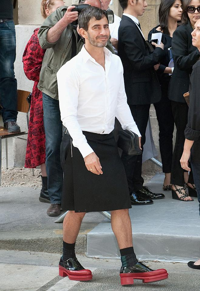 The following day, designer Marc Jacobs arrived at the Christian Dior Haute-Couture Show in one of his signature bizarre outfits, in this case a button-down white shirt, black skirt, and two-tone rubber platform shoes. You probably won't be seeing this ensemble on the runway! (7/2/2012)