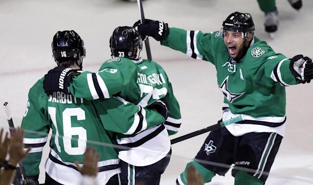 Dallas Stars defenseman Trevor Daley (6) skates over to celebrate a goal scored by teammate left wing Ryan Garbutt (16) with Alex Goligoski (33) during the first period of Game 6 of a first-round NHL hockey playoff series against the Anaheim Ducks in Dallas, Sunday, April 27, 2014. (AP Photo/LM Otero)