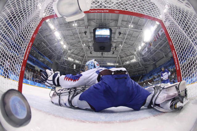 <p>The puck shot by Mark Arcobello (26), of the United States, sails past goalie Jan Laco (50), of Slovakia, during the second period of the qualification round of the men's hockey game at the 2018 Winter Olympics in Gangneung, South Korea, Tuesday, Feb. 20, 2018. (Bruce Bennet/Pool Photo via AP) </p>