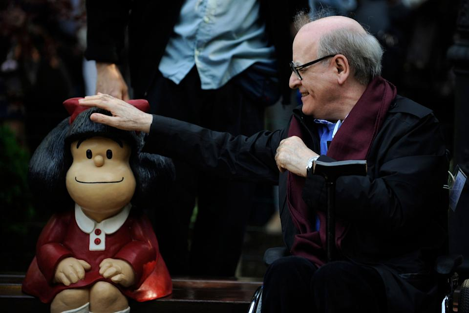 Cartoonist Joaquin Salvador Lavado, also known as Quino, touches a sculpture of his comic character Mafalda, during an opening ceremony of a park of San Francisco in Oviedo, northern Spain, October 23, 2014. Quino will be awarded with the 2014 Prince of Asturias Award for Communication and Humanities at a ceremony on Friday in the Asturian capital. The Prince of Asturias Awards have been held annually since 1981 to reward scientific, technical, cultural, social and humanitarian work done by individuals, teams and institutions. REUTERS/Eloy Alonso (SPAIN - Tags: SOCIETY MEDIA ENTERTAINMENT TPX IMAGES OF THE DAY) (Photo: Eloy Alonso / Reuters)