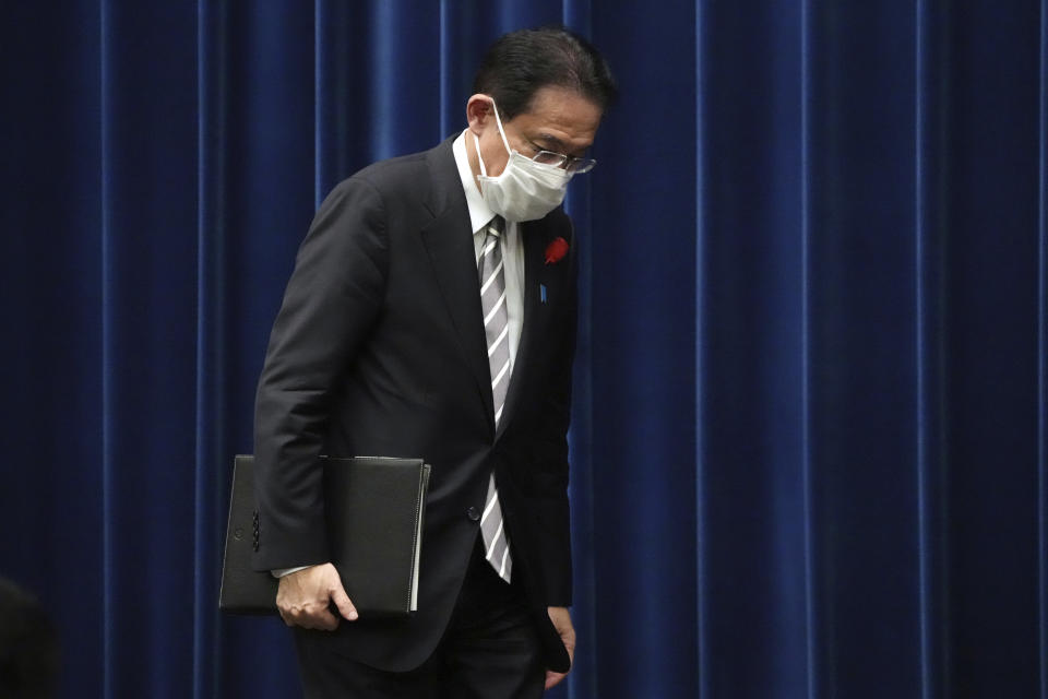 Japanese Prime Minister Fumio Kishida leaves a news conference at the prime minister's official residence Thursday, Oct. 14, 2021, in Tokyo. (AP Photo/Eugene Hoshiko, Pool)