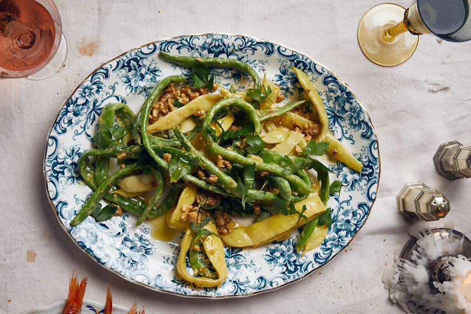 "Romano beans, also known as Italian pole beans, are wide and flat and have a less delicate texture than green beans but share their mild and sweet flavor. <a href=""https://www.epicurious.com/recipes/food/views/romano-beans-with-mustard-vinaigrette-and-walnuts?mbid=synd_yahoo_rss"" rel=""nofollow noopener"" target=""_blank"" data-ylk=""slk:See recipe."" class=""link rapid-noclick-resp"">See recipe.</a>"