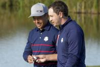 Team USA's Scottie Scheffler talks to Team USA's Patrick Cantlay during a foursome match the Ryder Cup at the Whistling Straits Golf Course Friday, Sept. 24, 2021, in Sheboygan, Wis. (AP Photo/Charlie Neibergall)