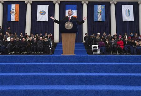 New York City Mayor Bill de Blasio, flanked by the flags of the five city boroughs, makes a speech during his inauguration ceremony on the steps of City Hall in New York