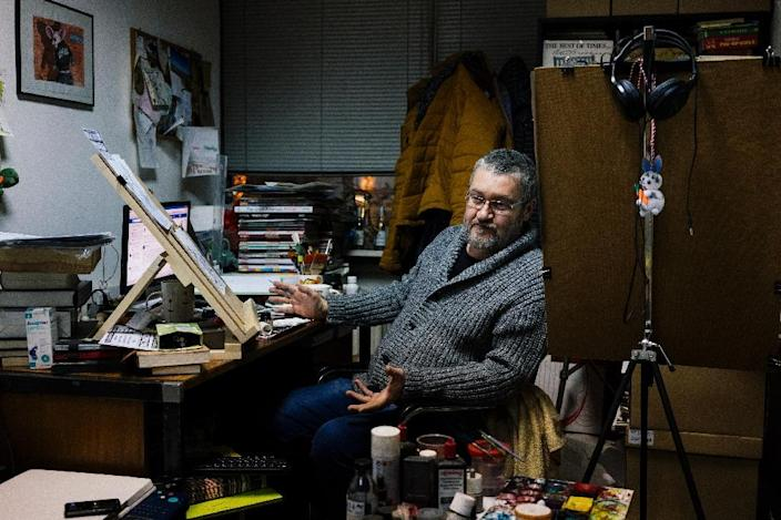 Hristo Komarnitski said he and his fellow cartoonists do not go as far as other in Britain or France (AFP Photo/Dimitar DILKOFF)