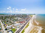 The bustling port city of Galveston is one of the best places to hit the beach in the Lone Star State. With 30-plus miles of sand to stroll and surf to wade in, your mood will be buoyed in no time. There's a party energy here too, with swim-up and rooftop bars and some celebration-worthy seafood towers at the century-old Gaido's.