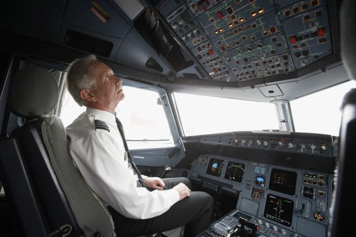 "Capt. Chesley 'Sully' Sullenberger goes through his pre-flight routine before piloting a flight to North Carolina from LaGuardia Airport in New York in this file photo from October 1, 2009. Sullenberger was the pilot who brought a crippled US Airways jet to a textbook emergency landing on New York City's Hudson River, after the Airbus A320 was struck by birds, blowing out the engines of the plane, moments after take-off from New York's LaGuardia airport in January. January 15, 2014 marks the fifth anniversary of ""The Miracle on the Hudson."" REUTERS/Seth Wenig/Pool/Files (UNITED STATES - Tags: TRANSPORT PROFILE ANNIVERSARY)"