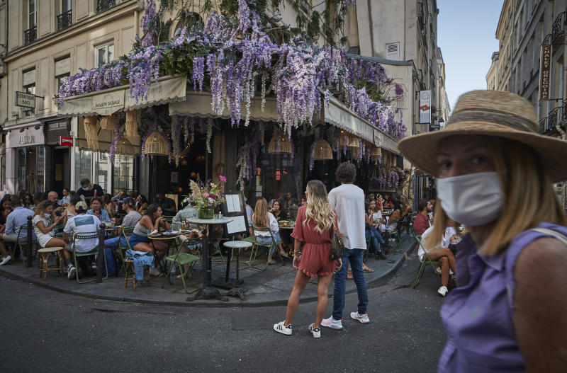PARIS, FRANCE - SEPTEMBER 13: Parisians enjoy the late summer weather in packed cafes and restaurants on the Rue de Buci, Paris, despite the recent surge in Covid-19 infections throughout Paris and France on September 13, 2020 in Paris, France. On Saturday, the number of new daily cases in France exceeded 10,000, with infection rates rising among all age groups. (Photo by Kiran Ridley/Getty Images)