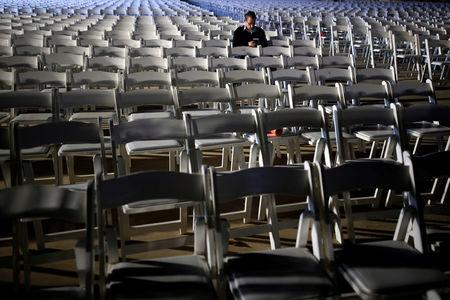 A student at the IAF academy sits within empty chairs waiting for the arrival of the first F-35s ordered by the Israeli air force to Israel at Nevatim in southern Israel