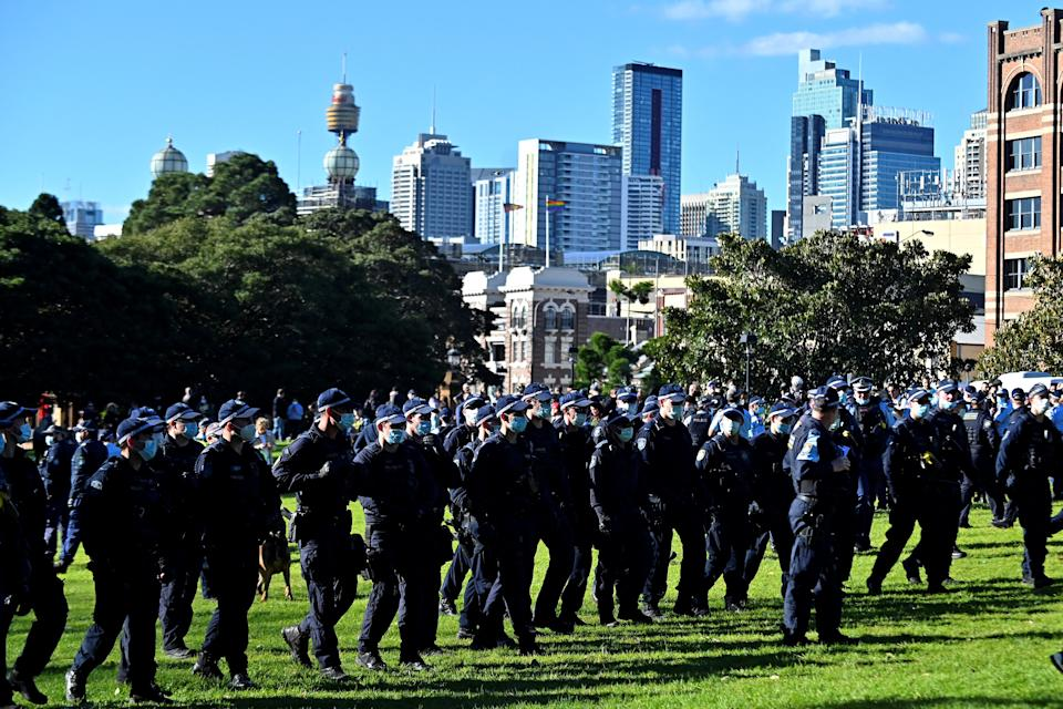 Police block the way to the marching protesters during an anti-lockdown rally in Sydney yesterday. Source: Getty