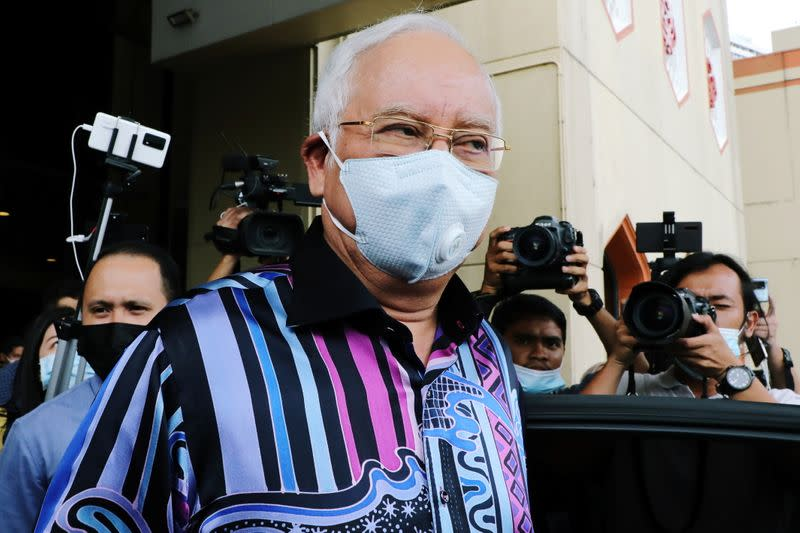 Former Malaysian Prime Minister Najib Razak leaves after a meeting at United Malays National Organization (UMNO) headquarters in Kuala Lumpur