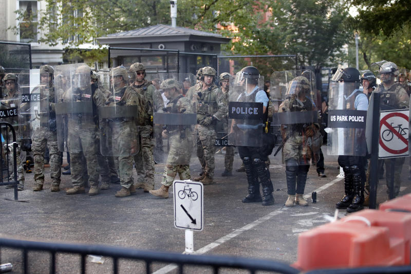 Members of the DC National Guard and US Park Police stand on guard near the White House in Washington. Source: AP