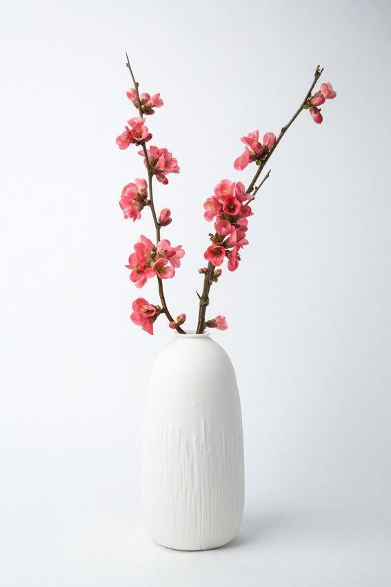 """<p>marieburgosdesignthestore.com</p><p><strong>$24.00</strong></p><p><a href=""""https://www.marieburgosdesignthestore.com/vases/vase-soliflore-small"""" rel=""""nofollow noopener"""" target=""""_blank"""" data-ylk=""""slk:BUY NOW"""" class=""""link rapid-noclick-resp"""">BUY NOW</a></p><p>If you're bringing flowers, it can't hurt to bring a stylish vase to put them in, too. </p>"""