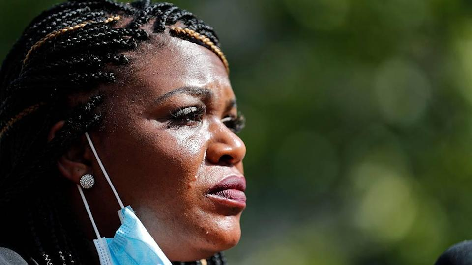 Activist Cori Bush speaks during a news conference Wednesday, Aug. 5, 2020, in St. Louis. Bush pulled a political upset on Tuesday, beating incumbent Rep. William Lacy Clay in Missouri's 1st District Democratic primary. (AP Photo/Jeff Roberson)