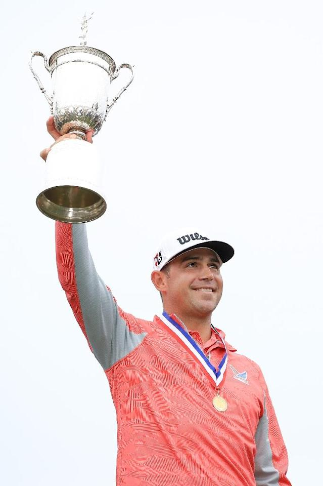 Gary Woodland holds the US Open champion's trophy after winning his first major title Sunday at Pebble Beach (AFP Photo/Andrew Redington)