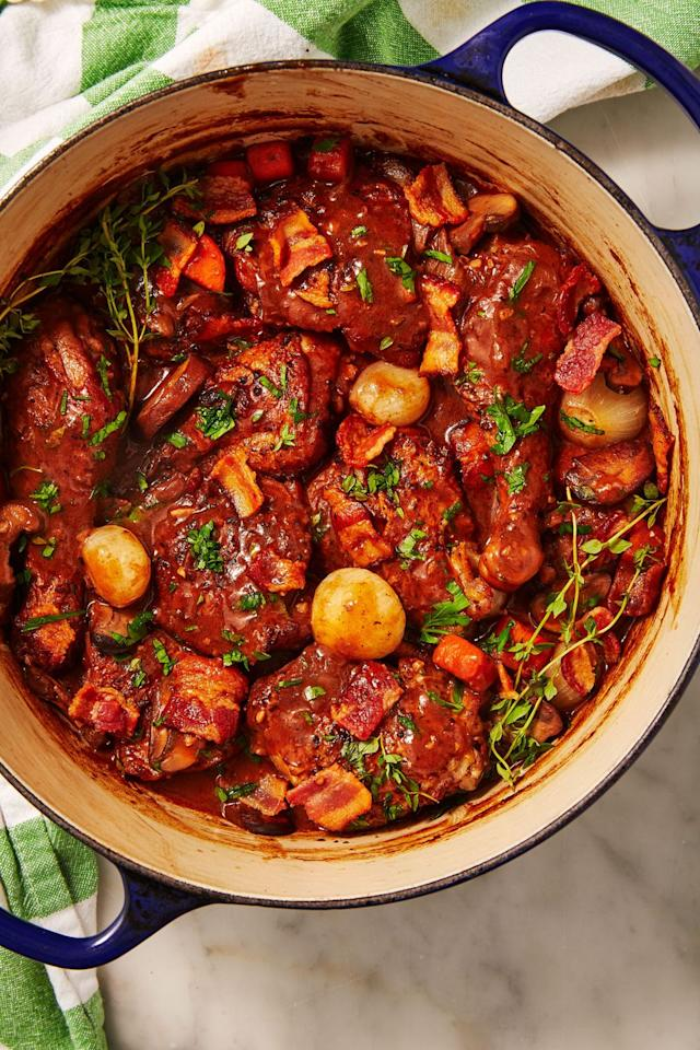 "<p>Don't be intimidated. Coq au vin is essentially just chicken stew. The wine, butter, and bacon will make your bag of frozen carrots and pearl onions taste extra fancy. </p><p>Get the recipe from <a href=""https://www.delish.com/cooking/recipe-ideas/a30875984/coq-au-vin-recipe/"" target=""_blank"">Delish</a>.</p>"