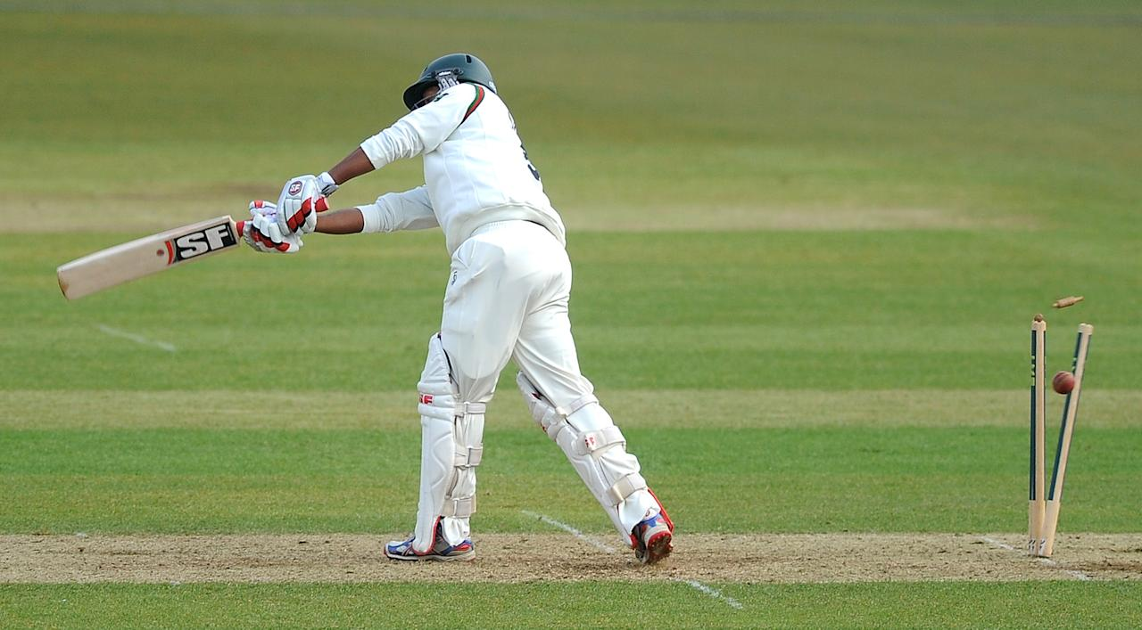 SOUTHAMPTON, ENGLAND - APRIL 11: Ramnaresh Sarwan of Leicestershire is bowled out during day two of the LV County Championship match between Hampshire and Leicestershire at The Ageas Bowl on April 11, 2013 in Southampton, England. (Photo by Charlie Crowhurst/Getty Images)