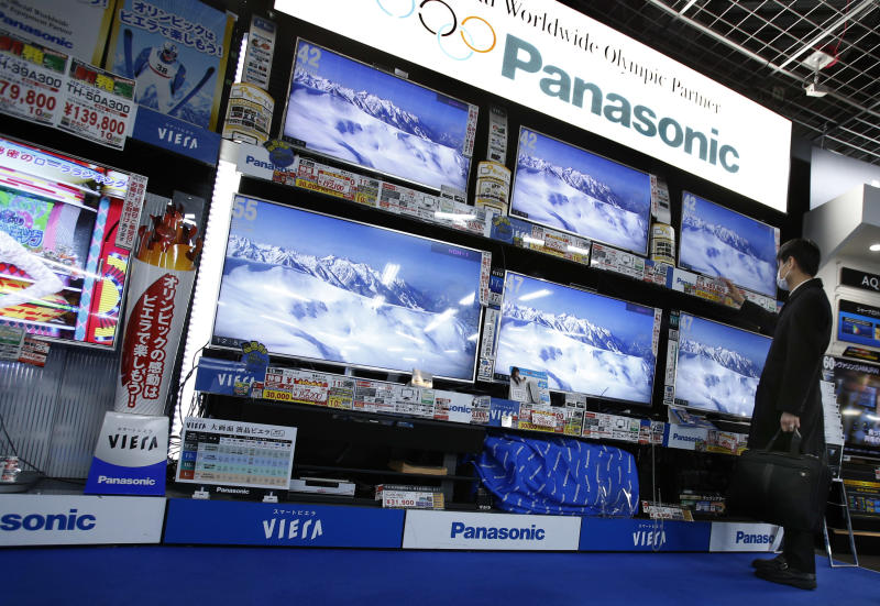 A shopper looks at Panasonic's flat-panel televisions at an electronics retail store in Tokyo Tuesday, Feb. 4, 2014. Panasonic Corp. says profit rose 20 percent in the October-December quarter as growth in businesses such as smart home systems offset its long struggling TV and appliance divisions. The Japanese manufacturing giant reported net income of 73.7 billion yen ($728 million), up from 61.3 billion yen a year earlier. (AP Photo/Shizuo Kambayashi)