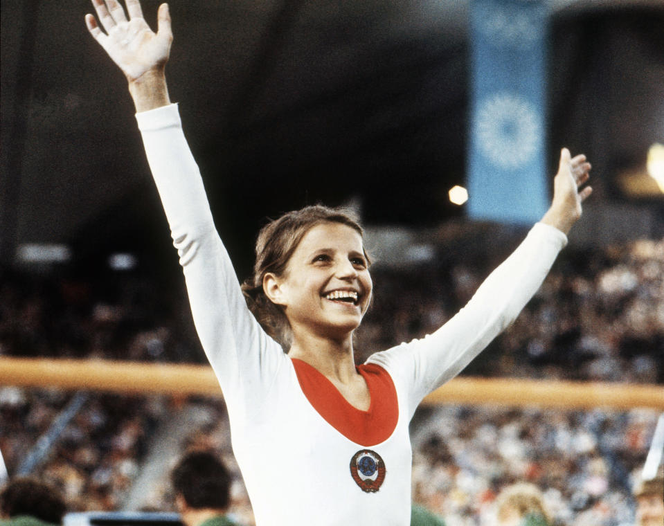 FILE - In this Aug. 1972, file photo, Olga Korbut, of Russia, throws up her arms in joy after winning the Individual Women's Gymnastic event at the 1972 Summer Olympics in Munich, Germany. (AP Photo/File)