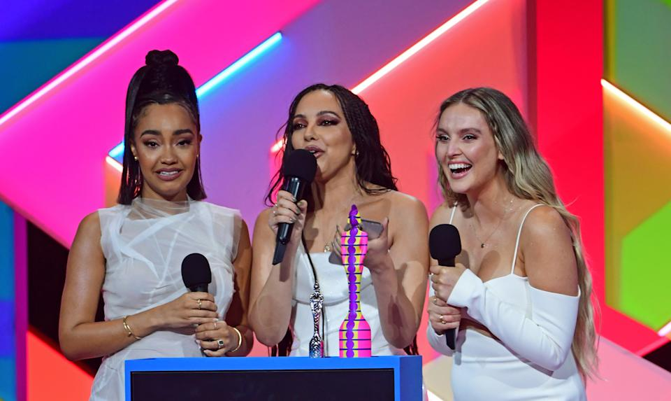 Little Mix accept the award for Best British Group during the Brit Awards 2021 at the O2 Arena, London. Picture date: Tuesday May 11, 2021. (Photo by Ian West/PA Images via Getty Images)