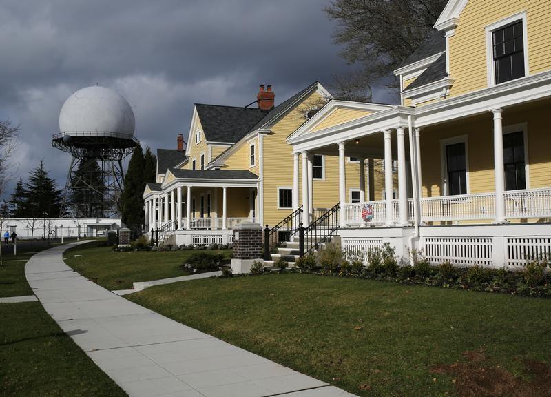 Officers' housing for sale are seen near a functioning FAA air traffic control radar dome in Seattle
